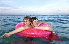 Free Brothers In A Swim Ring Have Fun In The Ocean Stock Photography - 15703882
