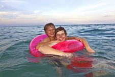 Free Brothers In A Swim Ring Have Fun In The Ocean Royalty Free Stock Photography - 15703927