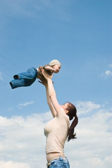 Free Mother Playing With Baby In The Sky Royalty Free Stock Photo - 15705195