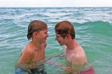 Boys Having Fun In The Clear Sea Stock Photography