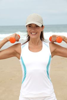Free Fitness Exercises On The Beach Royalty Free Stock Images - 15705719