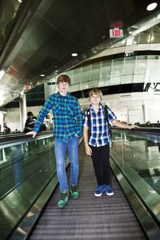 Free Young Boys On A Moving Staircase At The Airport Stock Photos - 15705893