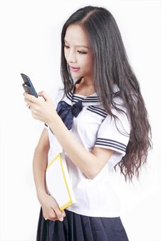Free Schoolgirl Sending Sms Royalty Free Stock Photo - 15708315