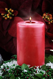 Free Lit Christmas Candle And Poinsettias Stock Image - 15709141
