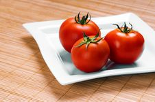 Ripe Tomatoes On Plate Royalty Free Stock Images