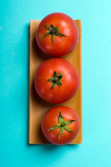 Free Ripe Tomatoes On Blue Stock Photo - 15709840