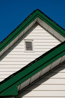 Farmhouse Roof Peak Against A Blue Sky. Royalty Free Stock Photography