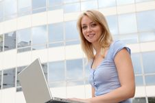 Free Blond Woman With Laptop In Front Of Building Stock Images - 15711294