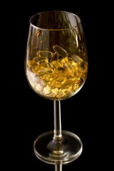 Free Capsules In The Wine Glass Stock Images - 15712504