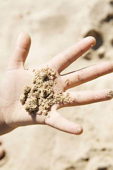 Small Hand Full Of Sand Stock Photo