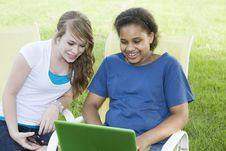 Two Girls Checking Computer Stock Image