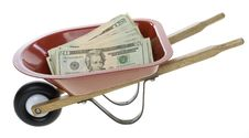 Free Twenty Dollar Bills In Red Wheelbarrow Stock Photos - 15715323