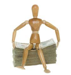Mannequin Sitting On Stack Of Twenty Dollar Bills Stock Images