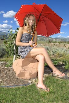 Teen Sit On Rock Stock Images