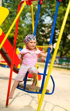 Free Little Girl On Seesaw Royalty Free Stock Photography - 15718317