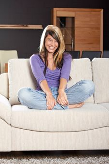 Woman In Living Room Is Smiling Royalty Free Stock Images