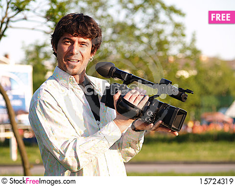 Free Photographer Holding Digital Camera Royalty Free Stock Images - 15724319