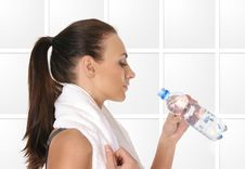 Free A Young And Sporty Female Is Drinking Water Stock Photos - 15720823