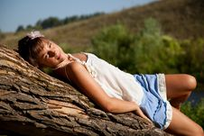 Free Girl Is Lying On A Tree Stock Image - 15721291
