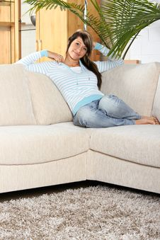 Woman Is Smiling And Relaxing Stock Photo