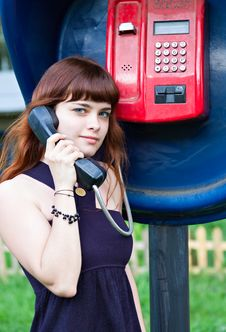 Free Young Girl In Telephone Box Royalty Free Stock Images - 15721939