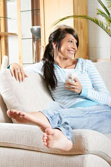 Woman Is Smiling And Relaxing Stock Images