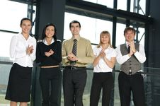 Five Business Persons Are Clapping Their Hands