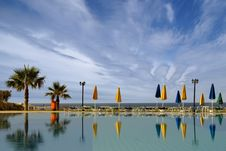 Free A Resort Image With Sky, Water And Palms Royalty Free Stock Photography - 15724267