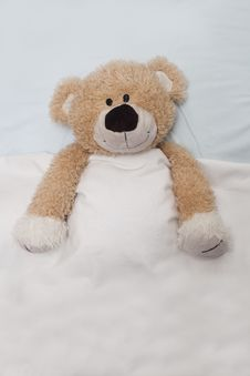 Free Teddy Bear Laying In Bed Stock Images - 15726484