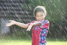 Free Girl Playing In Water Sprinkles Royalty Free Stock Photography - 15728257