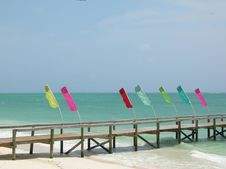 Free Colorful Flags On A Lonely Pier Royalty Free Stock Photo - 15728755