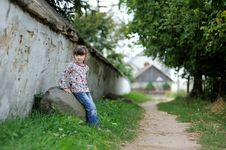 Free Nice Toddler Girl Near The Wall  On Country Road Stock Images - 15729224