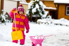 Nice Little Girl Playing With Snow Stock Photo