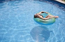 Free Girl Floating In Pool Royalty Free Stock Images - 15729499