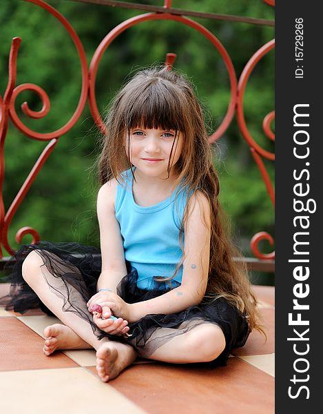 Adorable toddler girl with very long dark hair