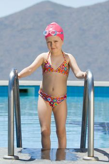 Free Little Girl In Bathing Cap, Glasses Walks Up Stair Stock Photos - 15730033