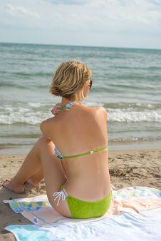 Sitting On The Beach Royalty Free Stock Photos