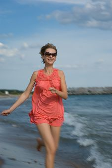 Free Young Woman Running On The Beach Stock Images - 15732924