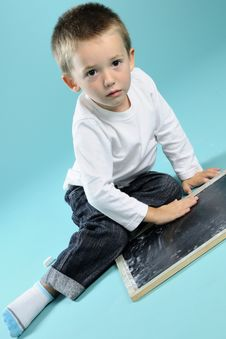 Free Little Boy Playing With Chalk On Black Board Stock Photography - 15733582