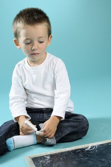 Free Little Boy Playing With Chalk On Black Board Royalty Free Stock Photo - 15733585