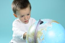 Free White Boy Learning Geography With Globe Royalty Free Stock Image - 15733596
