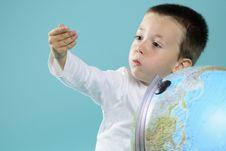 Free Caucasian Child Evaluating Destinations On Globe Stock Images - 15733634