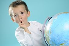 Free One Child Evaluating Destinations On Globe Stock Photography - 15733642