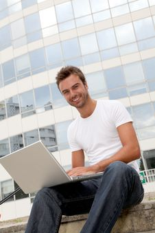 Free Smiling Young Man In Front Of Building Stock Image - 15734401