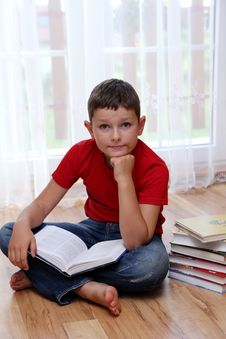 Free Boy Reading Book Stock Photo - 15734420