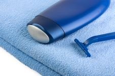 Free Shampoo And Razor On Blue Towel Stock Photography - 15744272