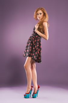 Beautiful Red-haired Girl On Purple Background Stock Photos