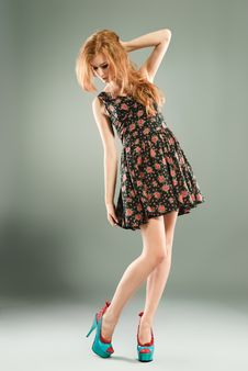 Beautiful Red-haired Girl On Grey Background Royalty Free Stock Photos