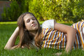 Free Pretty Young Teenage Girl Resting On The Grass Royalty Free Stock Image - 15756806