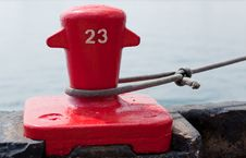 Free Red Dock Cleat Securing A Ship Stock Images - 15750664